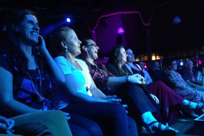 DADAA | audio description | audience with vision-impairment enjoying Fringe Festival show