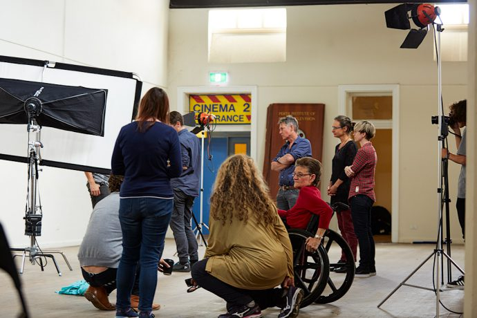 DADAA | Why Choose DADAA? | staff and artists with a photographer in the Fremantle Old Boys' School