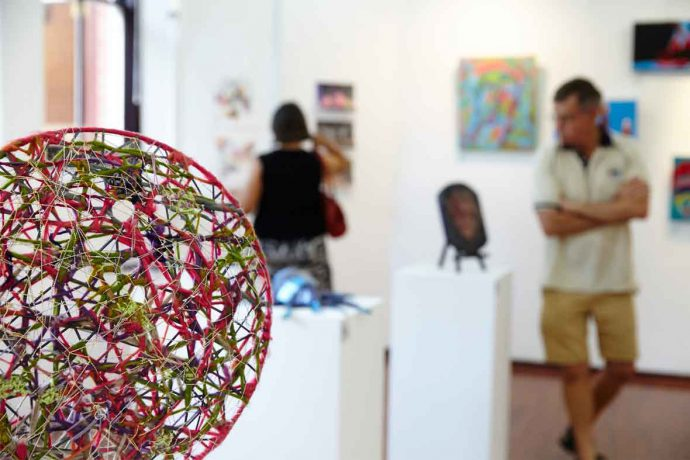 DADAA | fees and payment | round woven textile artwork in a gallery