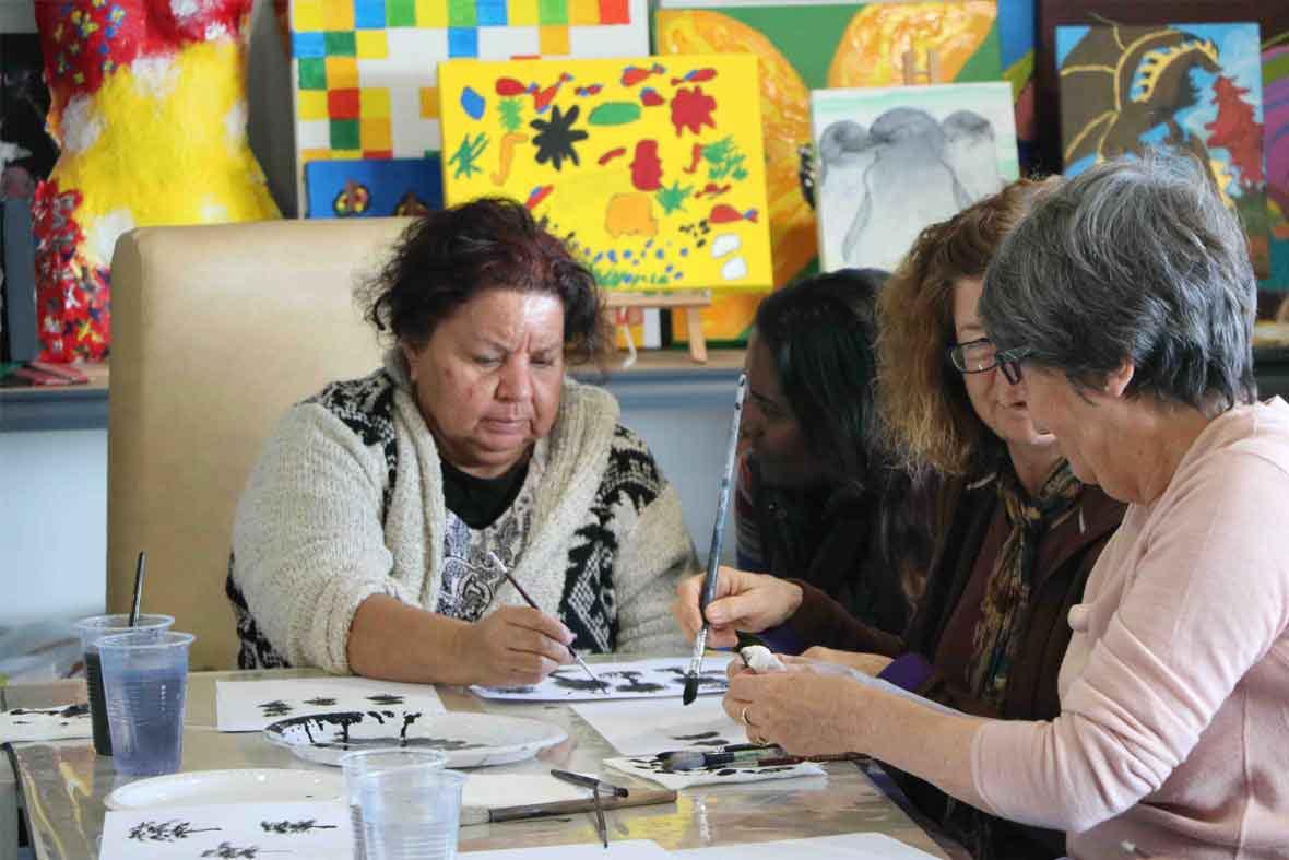 DADAA | aboriginal arts | artist Louisa Indich paints with three other women