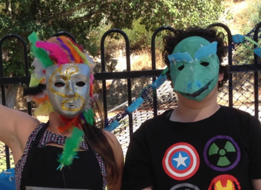 DADAA | Artlink | Two kids with brightly painted masks
