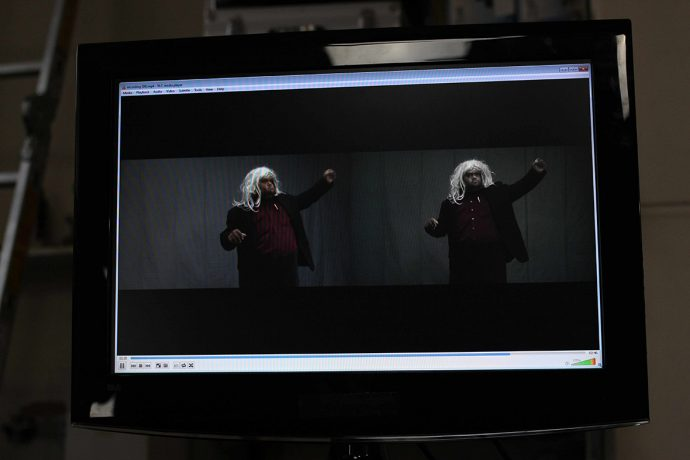 DADAA | Indigenous man with wig performs via computer screen