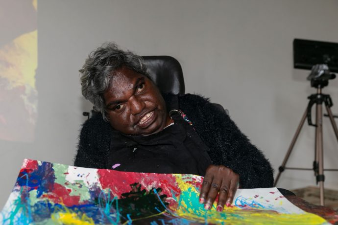 DADAA   artist with painting