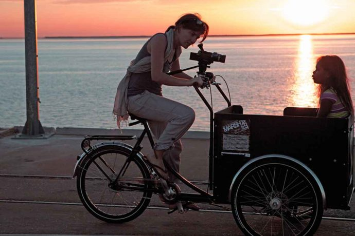 DADAA | Donations | artsworker on bicycle films young aboriginal girl