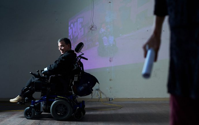 DADAA | Picture of a person in a wheelchair smiling on the stage