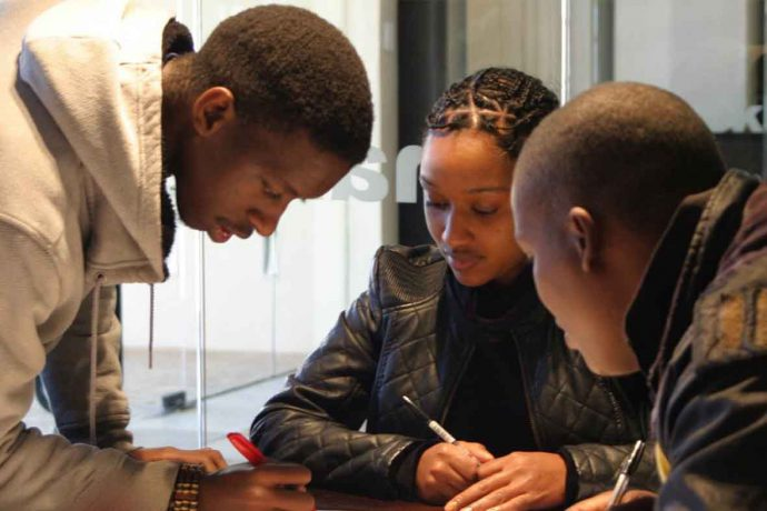 DADAA | international programs | three young adults working collaboratively in South Africa