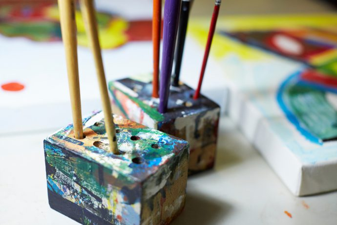 DADAA | publications | paintbrushes in a brightly coloured brush holder .