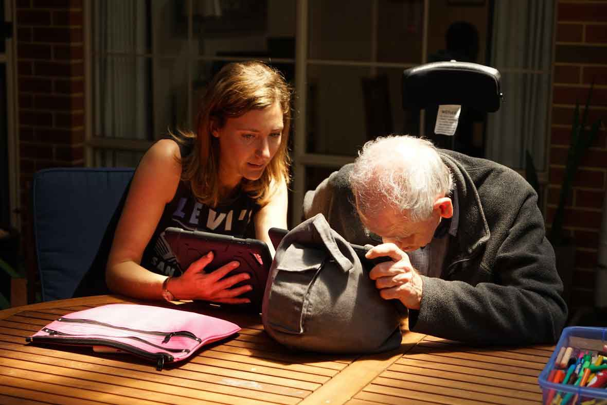 DADAA | skills training | artsworker training older person with disability in using an iPad