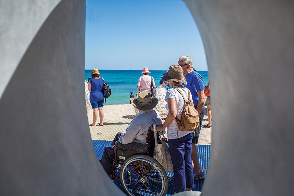 DADAA | Sculpture By The Sea | person in wheelchair at beach sculpture