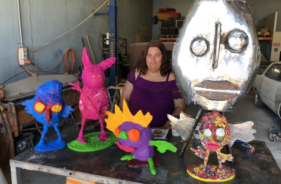 Artist Mandy White with maquettes of her sculptures